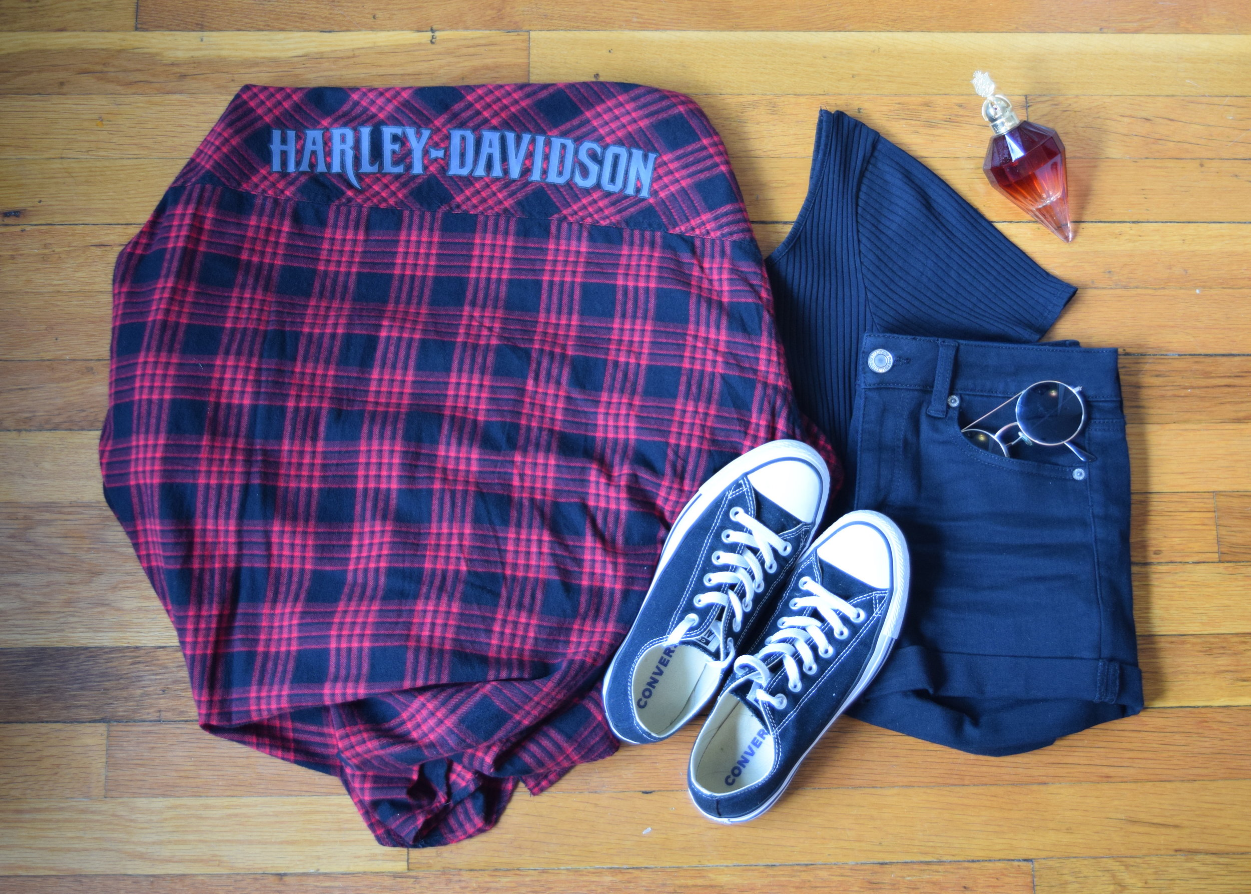 flannel .  bodysuit .  shorts .  sneakers .  perfume .  sunglasses  (similar).