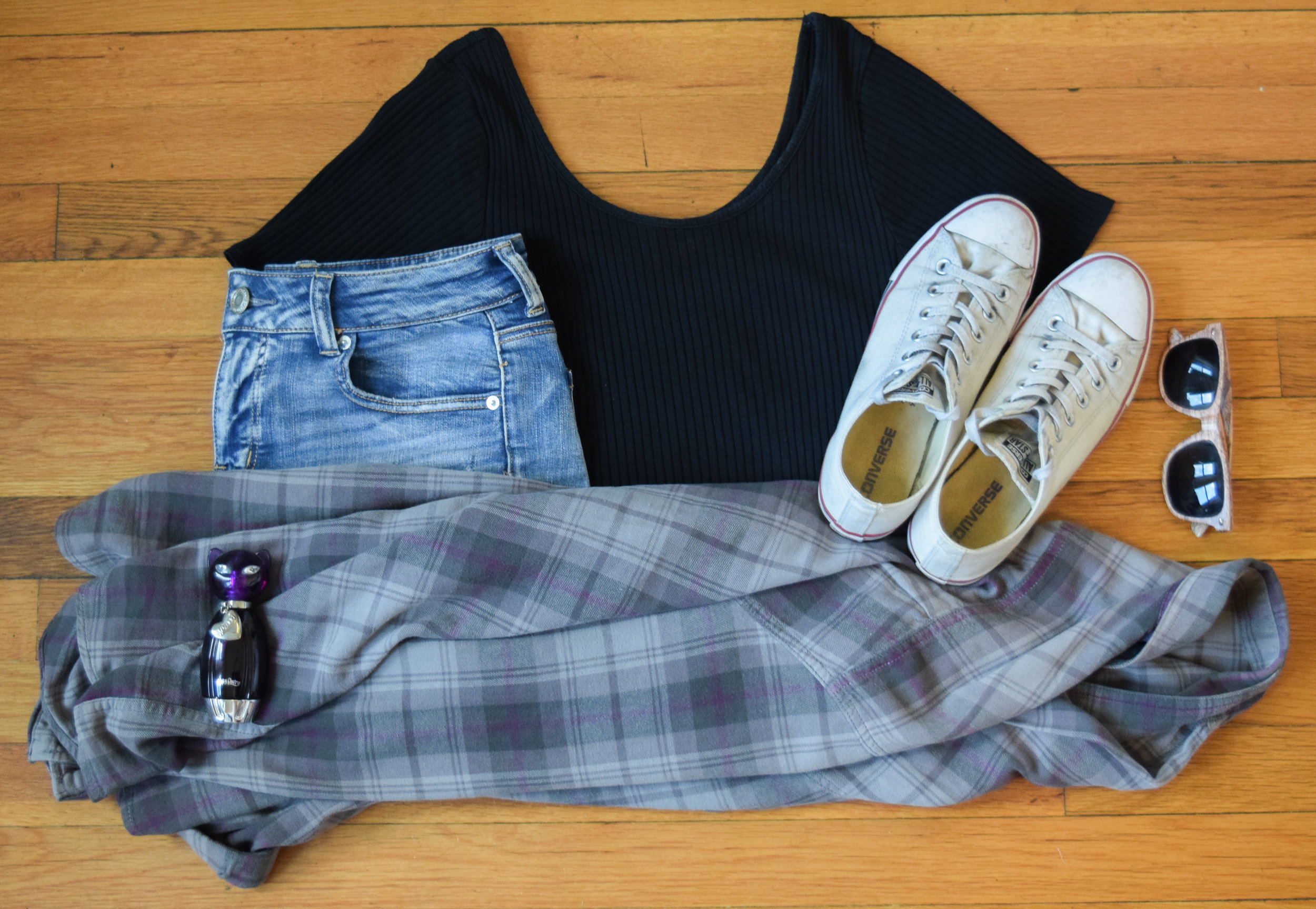 flannel (no clue, i'm sorry!).  bodysuit .  shorts .  sneakers .  perfume .  sunglasses  (similar, the linked pair is a bit darker).