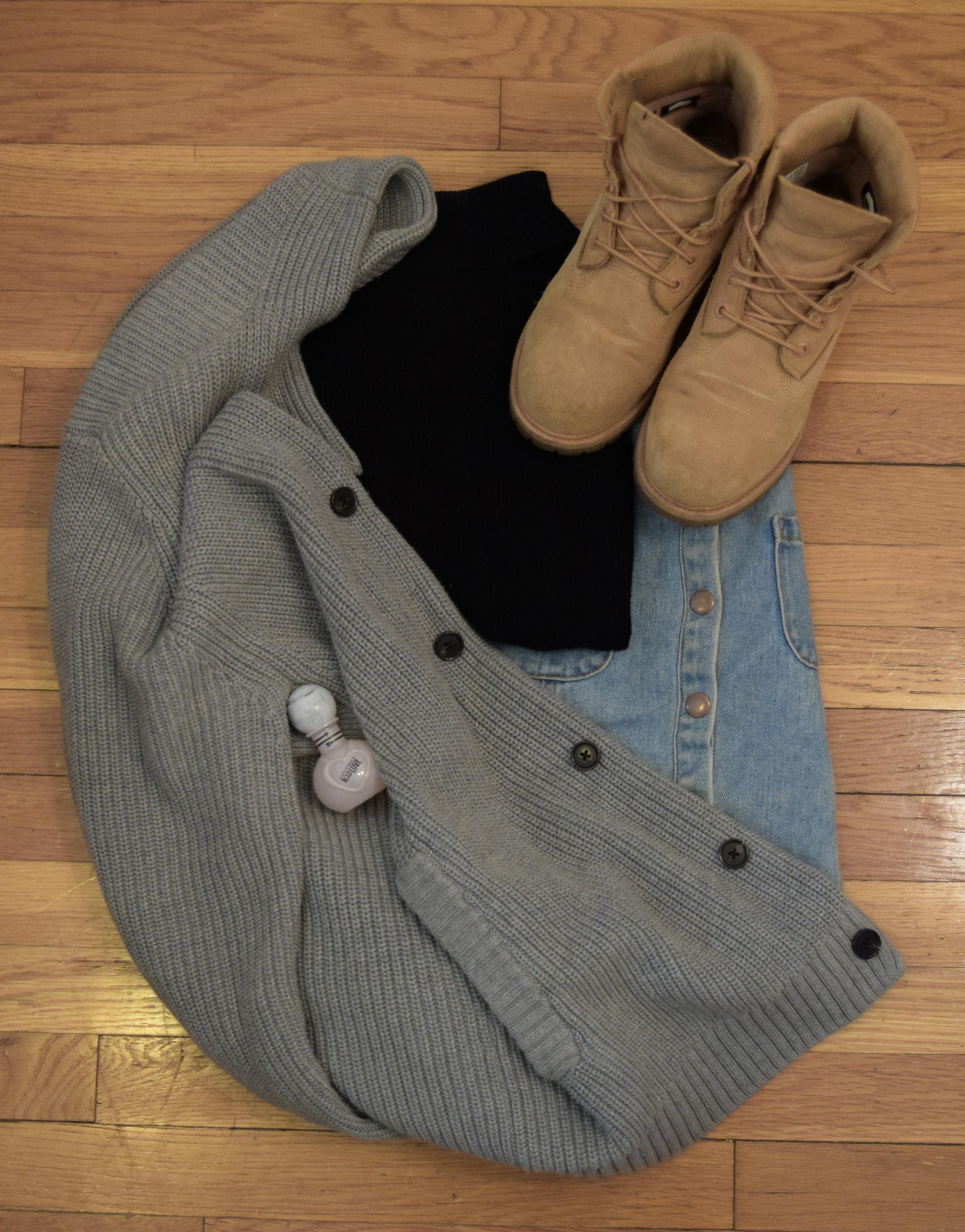 turtleneck .  skirt .  sweater .  boots .  perfume .