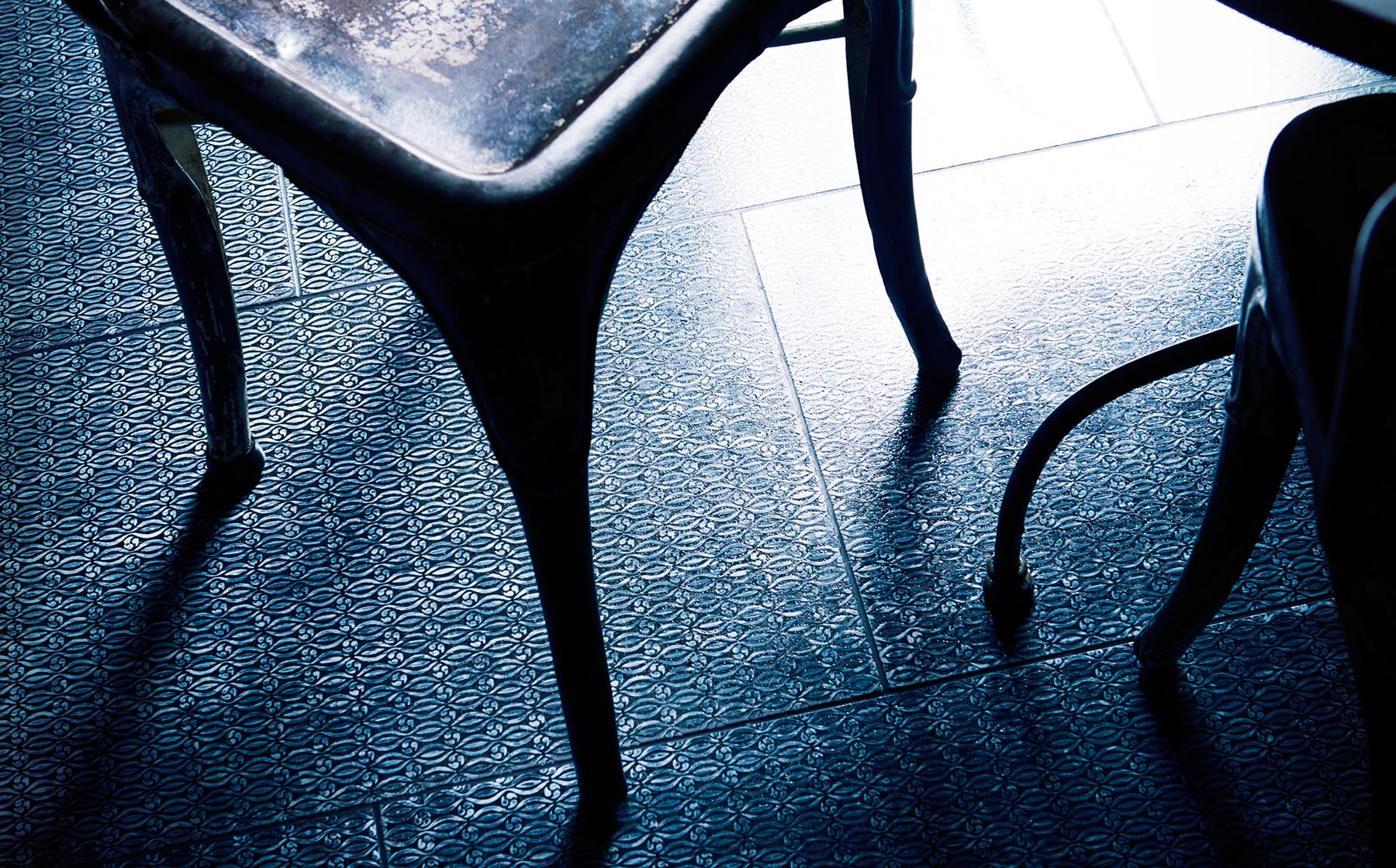 Graham Atkins-Hughes Black Chair on Tiled Floor