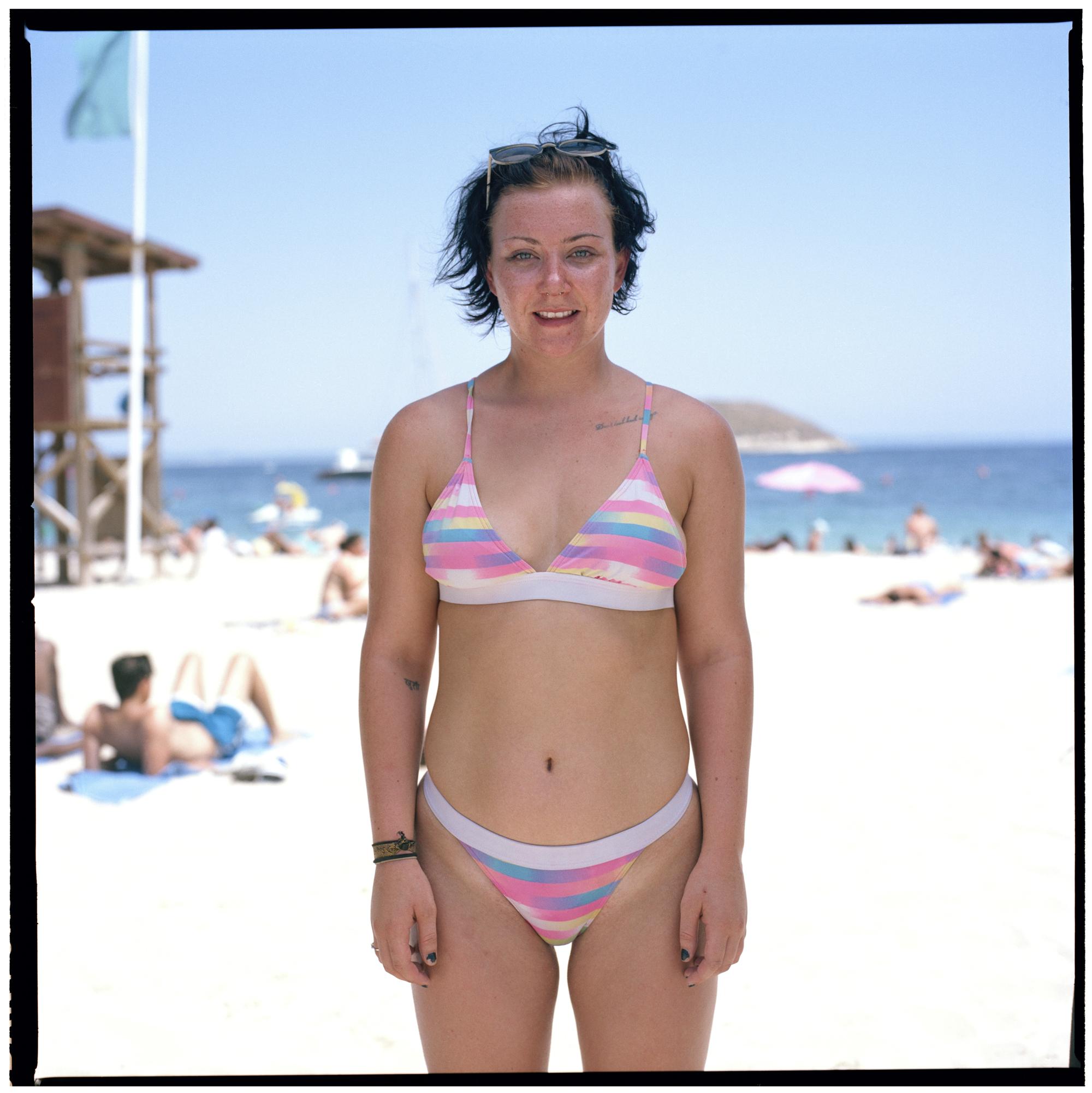 Grant Smith - Girl in striped bikini on beach