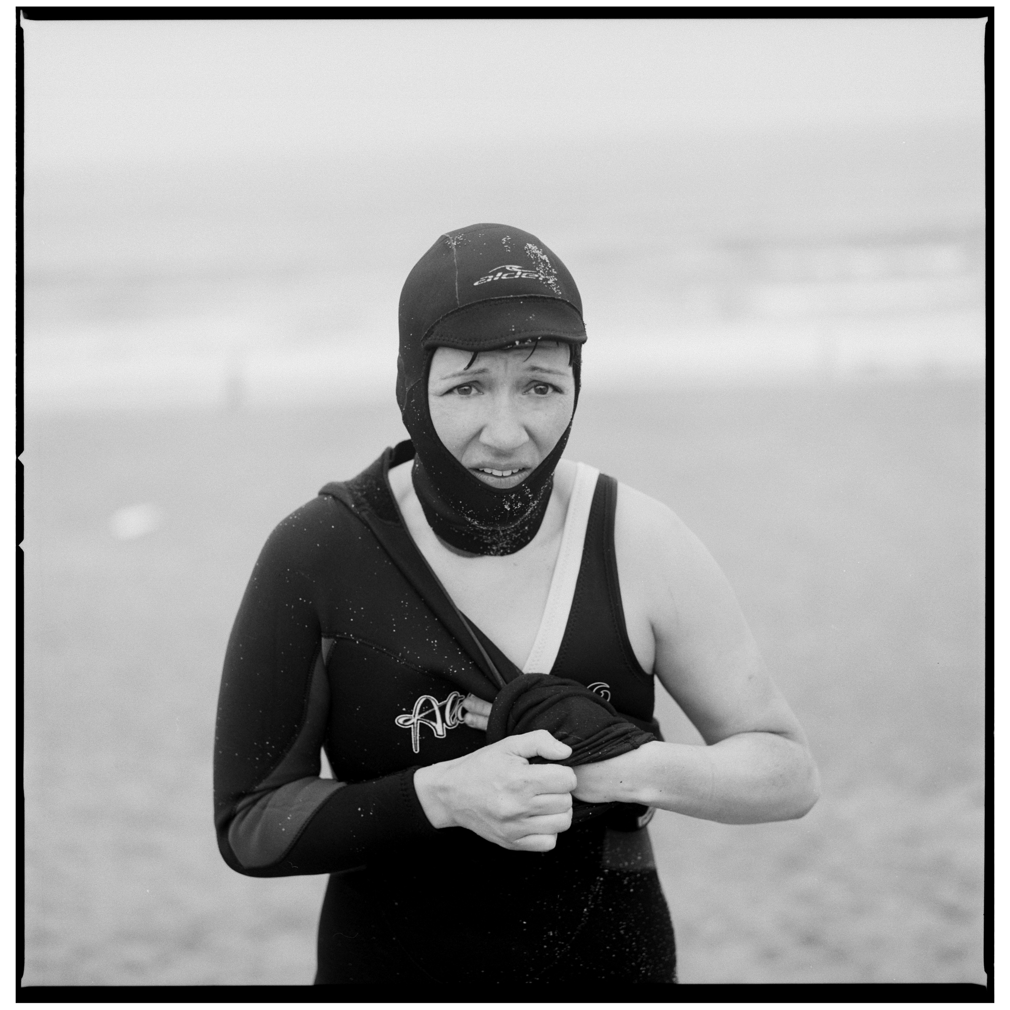 Grant Smith - The Chill - woman with wet suit half on