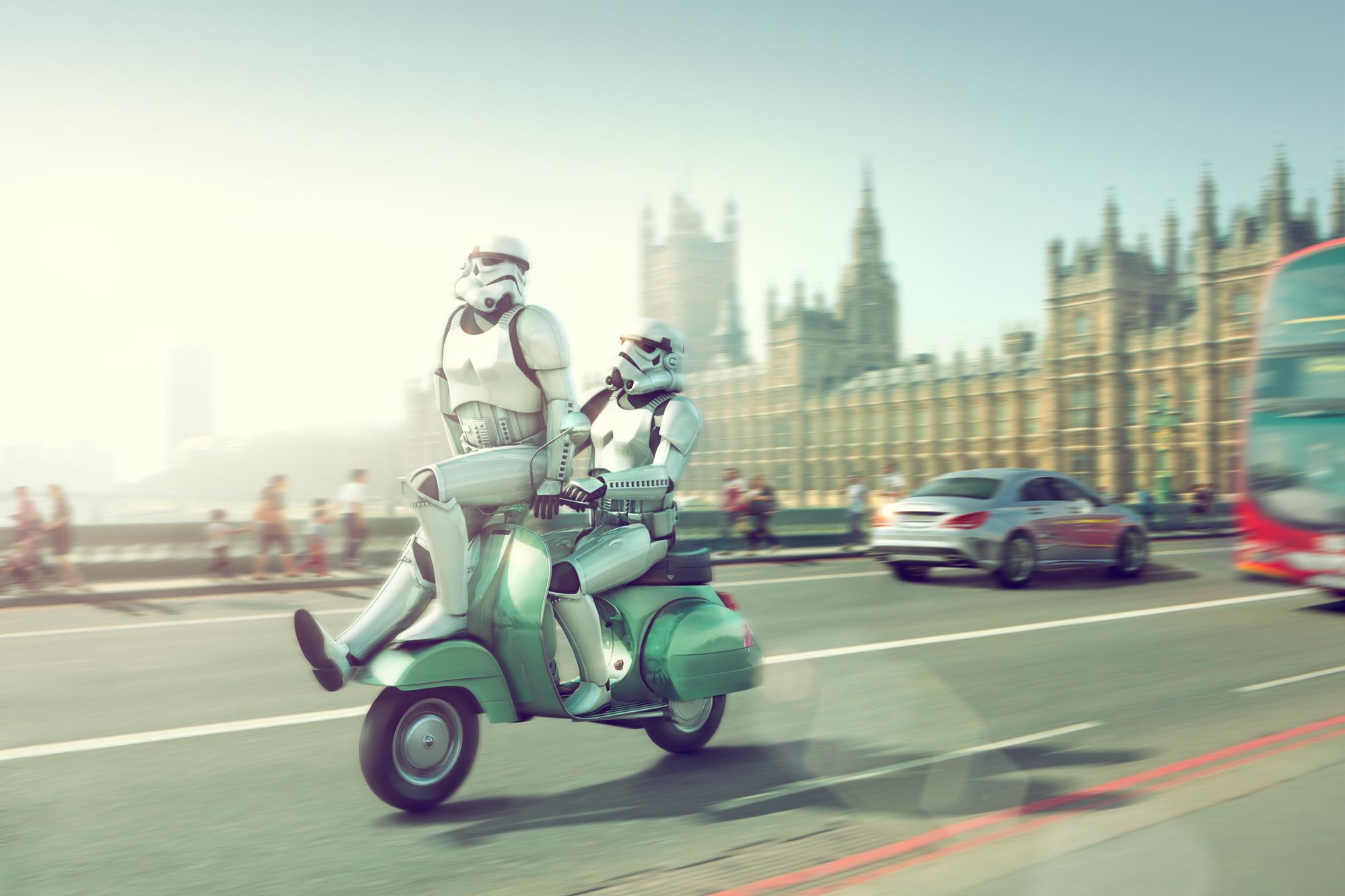 Chris Clor robots riding a vesta in London
