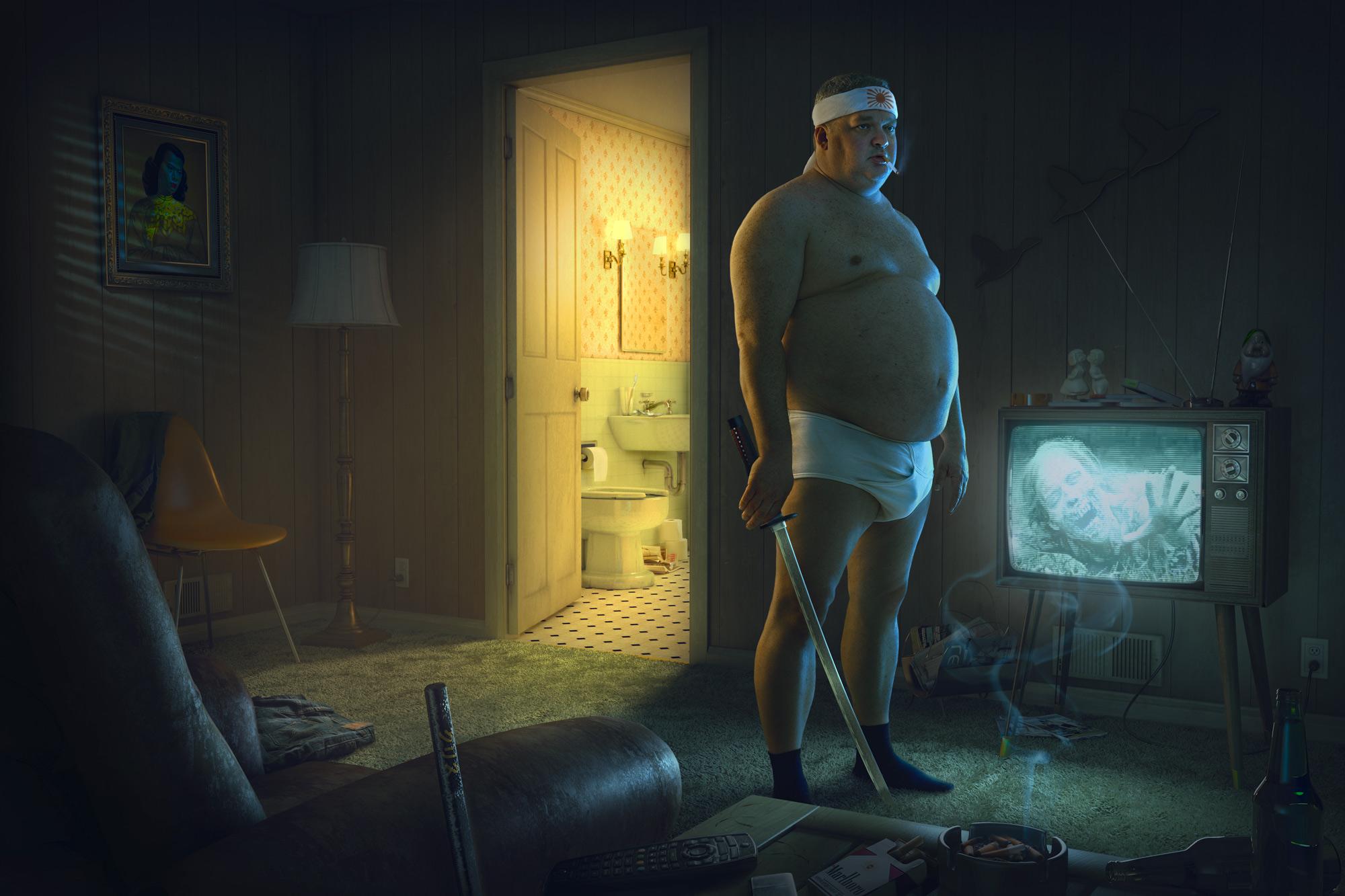 Chris Clor man in underpants in living room with sword