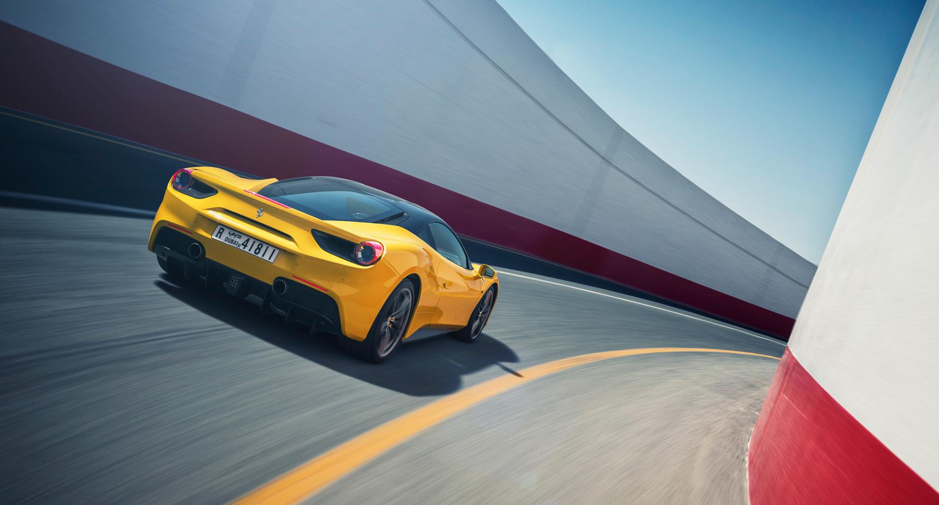 Nigel Harniman Yellow Ferrari car moving race track