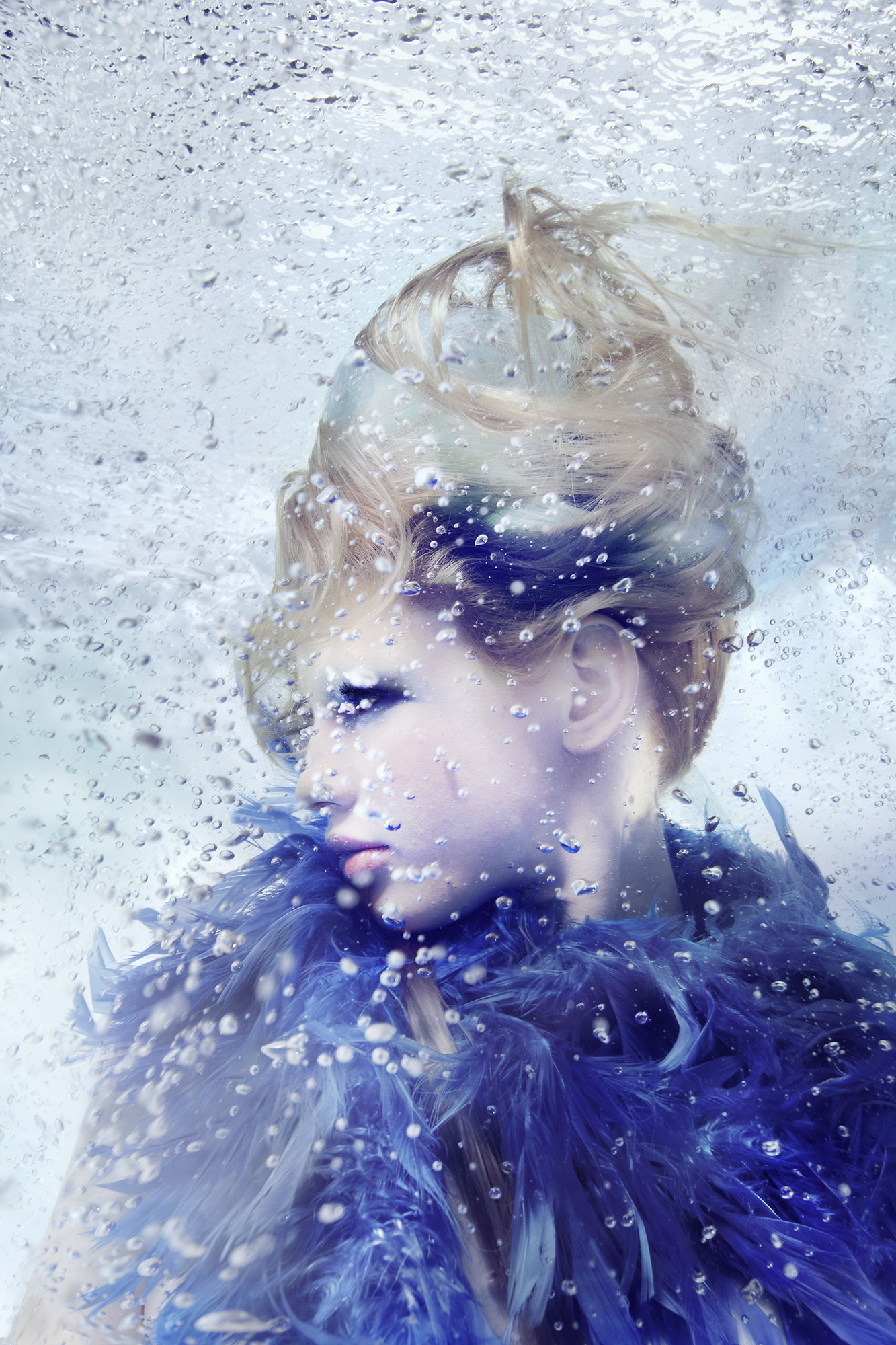 Susanne Stemmer profile of woman underwater blue feather scarf