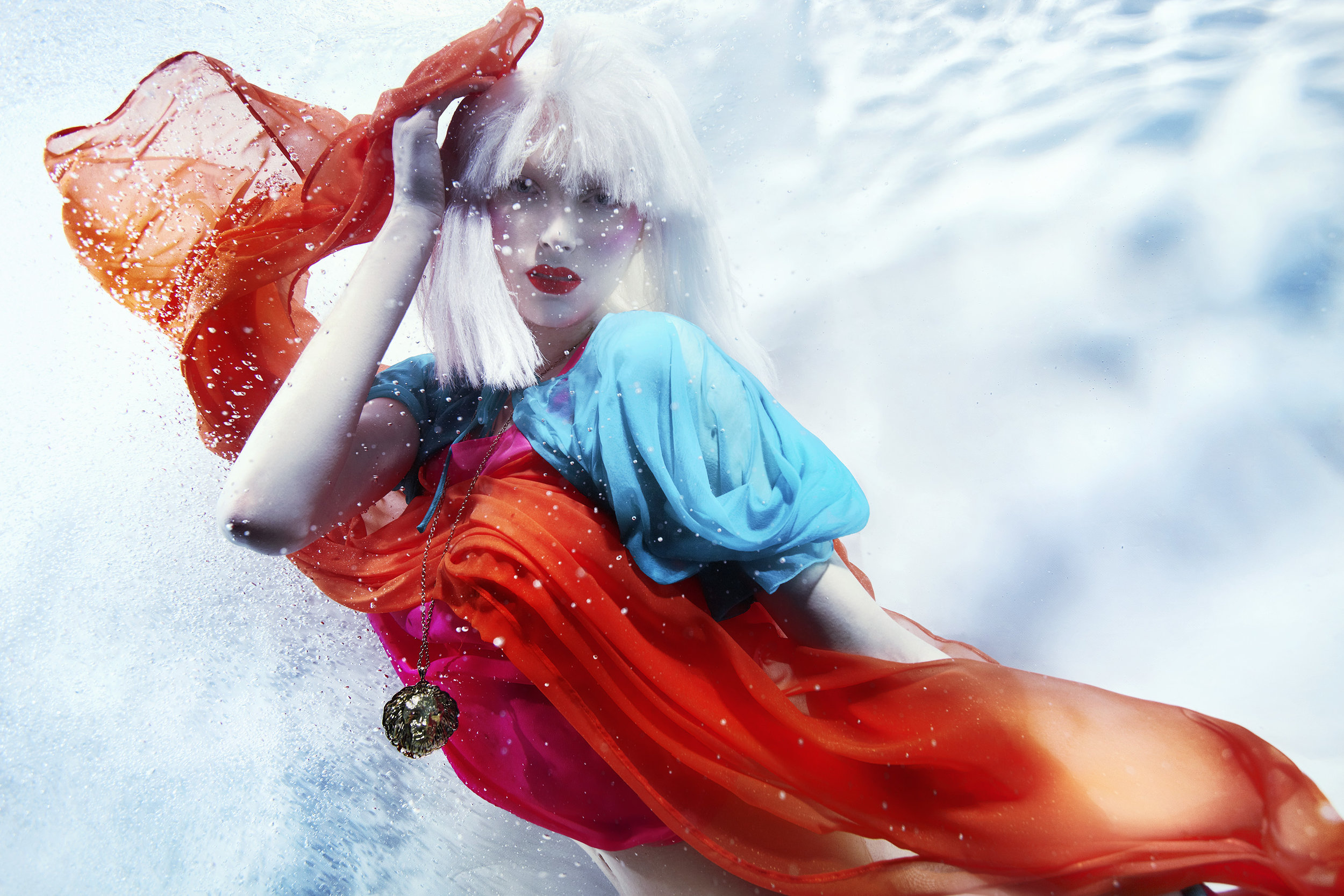 Susanne Stemmer girl underwater with white hair and red scarf