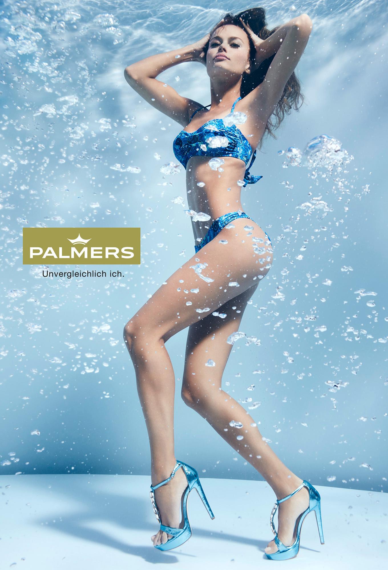 Susanne Stemmer girl standing on bottom of swimming pool in bikini and high heals