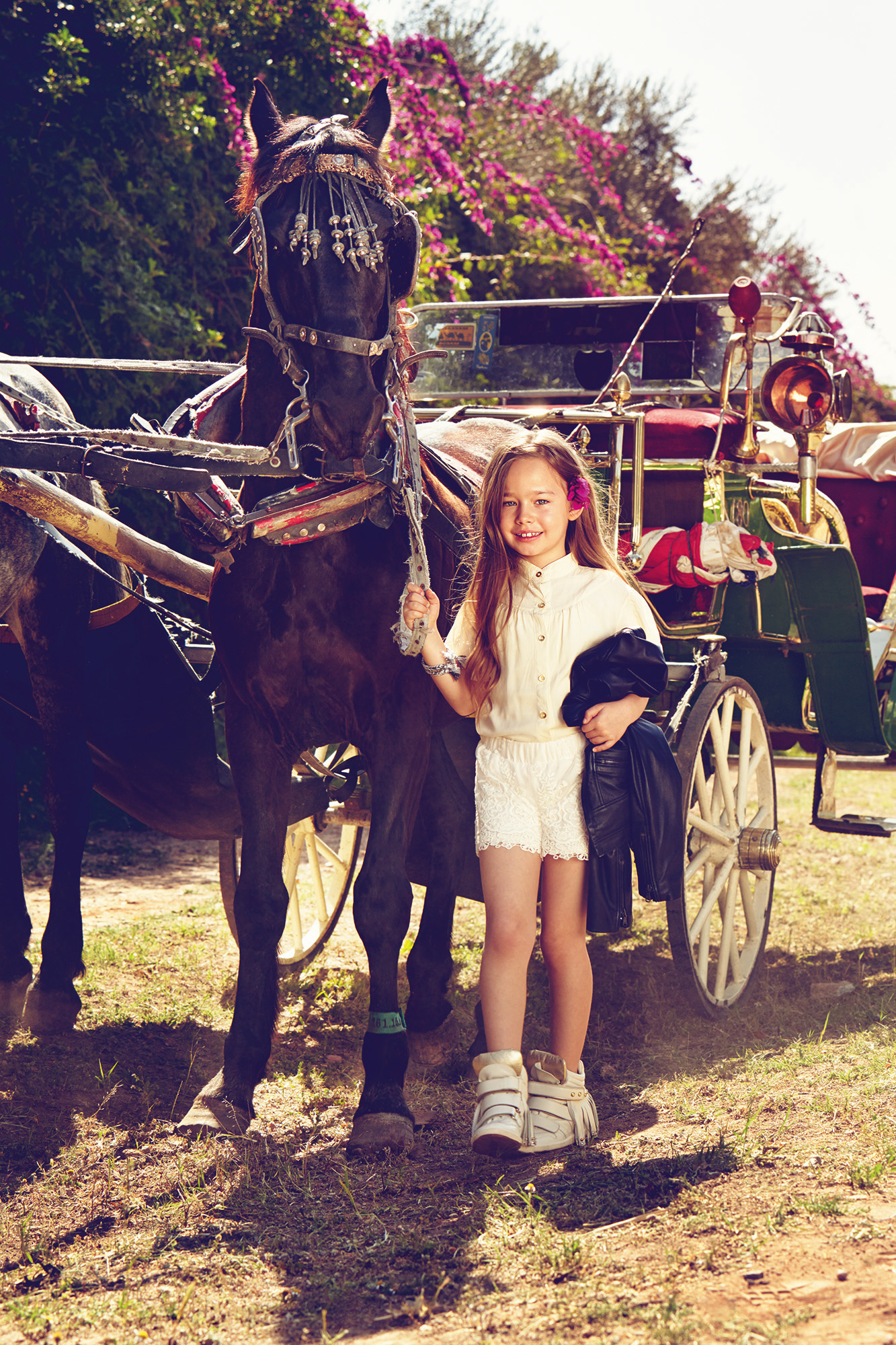 Ilve Little - girl standing by horse and cart