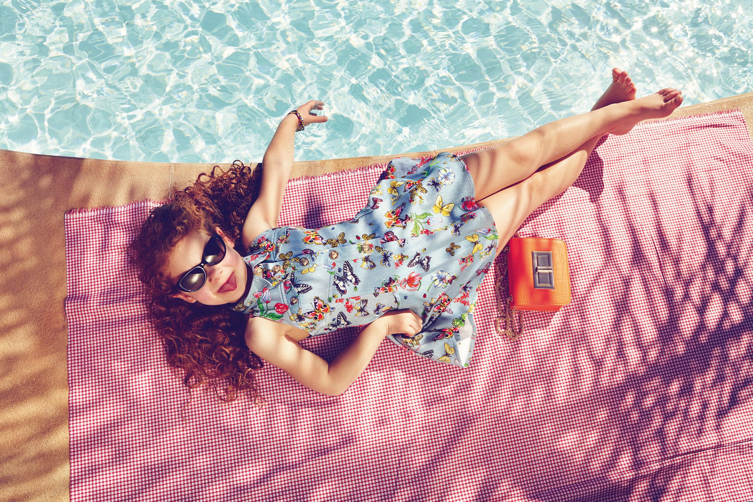 Ilve Little little girl lying by pool