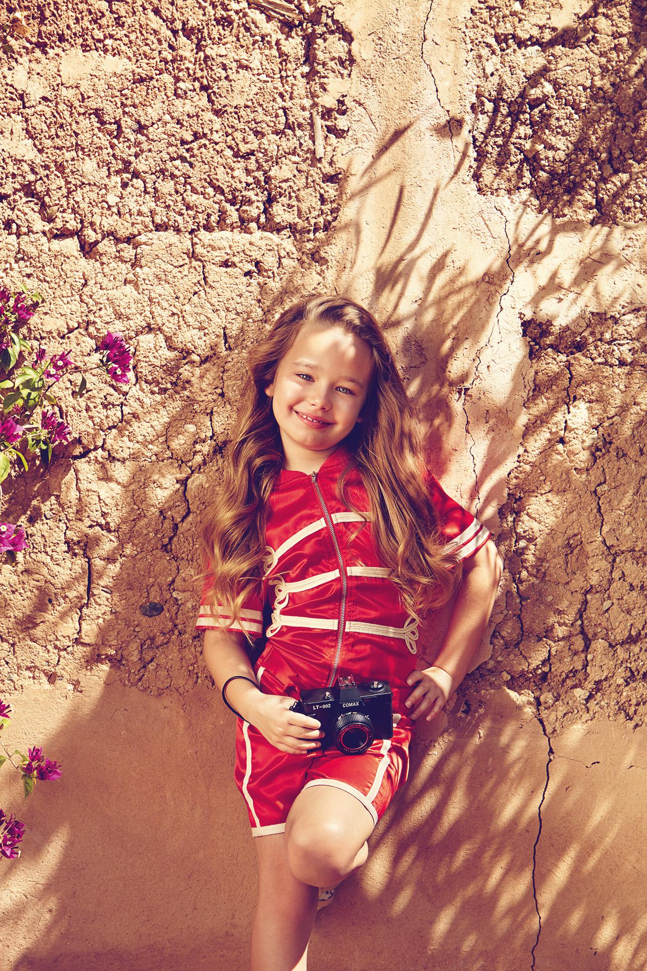 Ilve little - girl by rock face