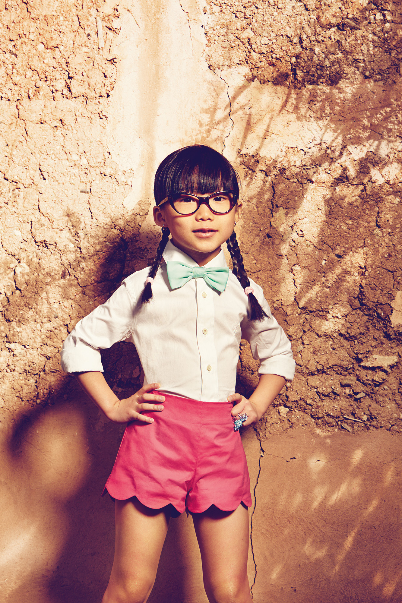 Ilve Little girl with spectacles agaist rock face