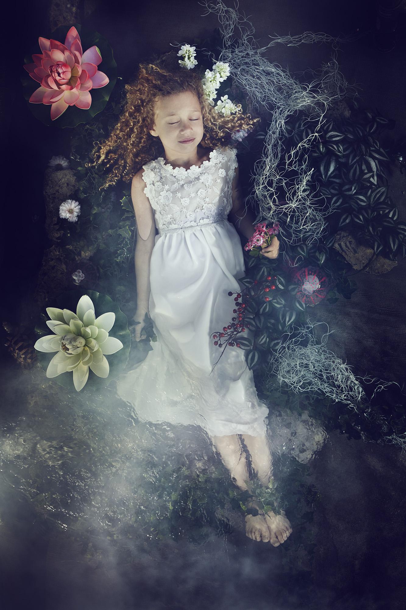 Ilve Little fantasy girl in flower bed
