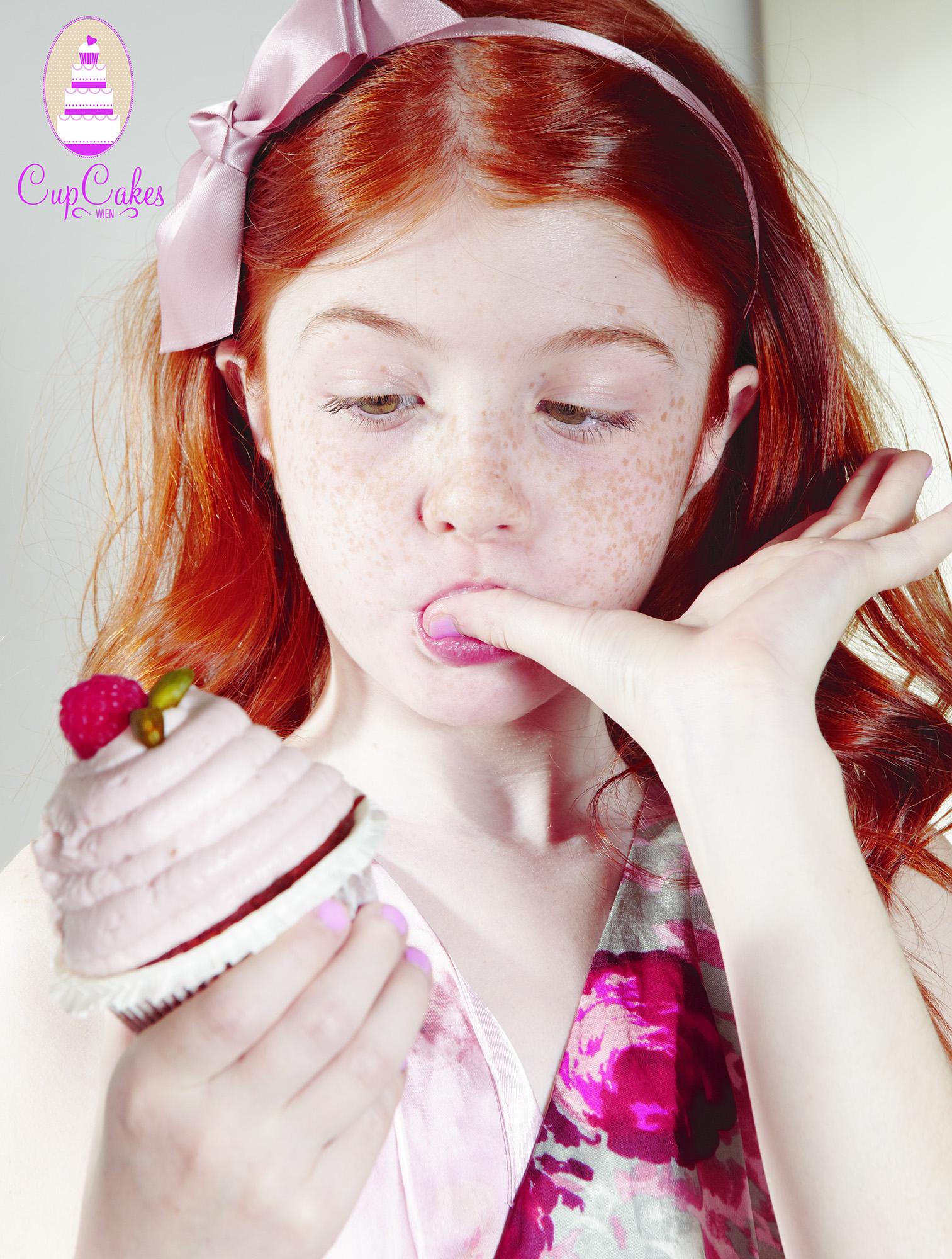 Ilve Little girl eating cupcake