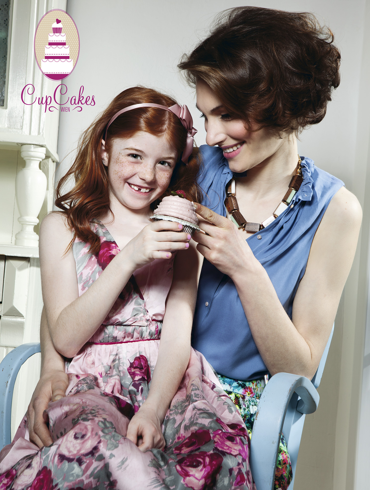 Ilve Little girl and mum eating cupcake