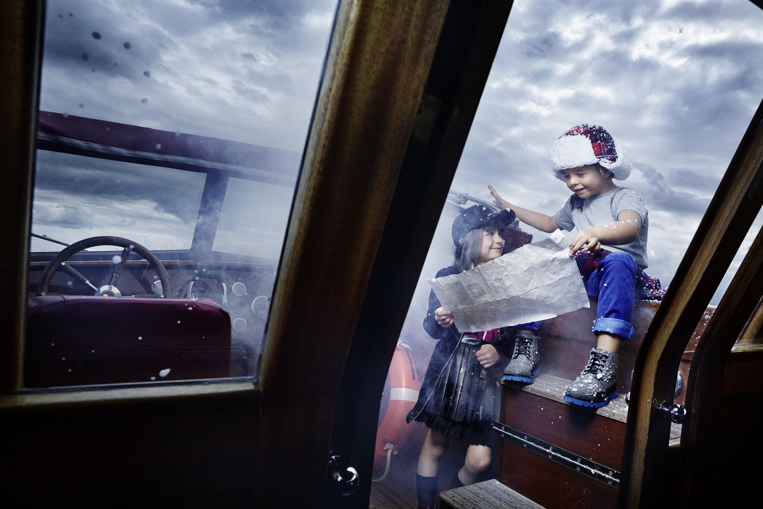 Ilve Little boys on board boat map reading