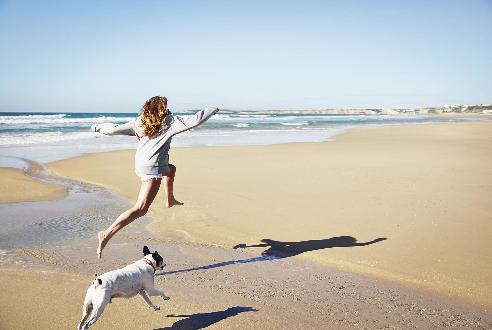 Karan Kapoor girl and dog running on beach