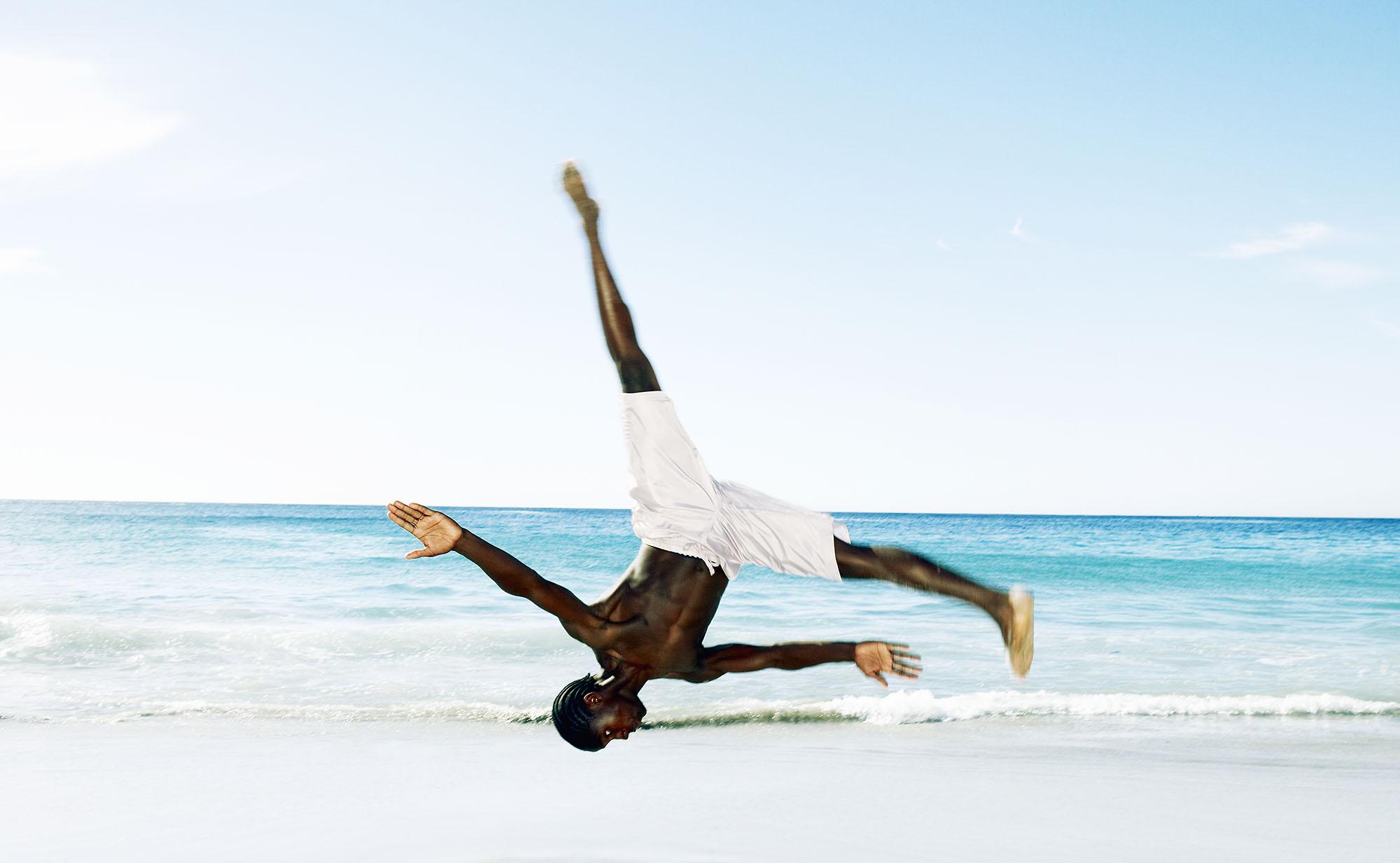 Karan Kapoor man somersaulting on beach