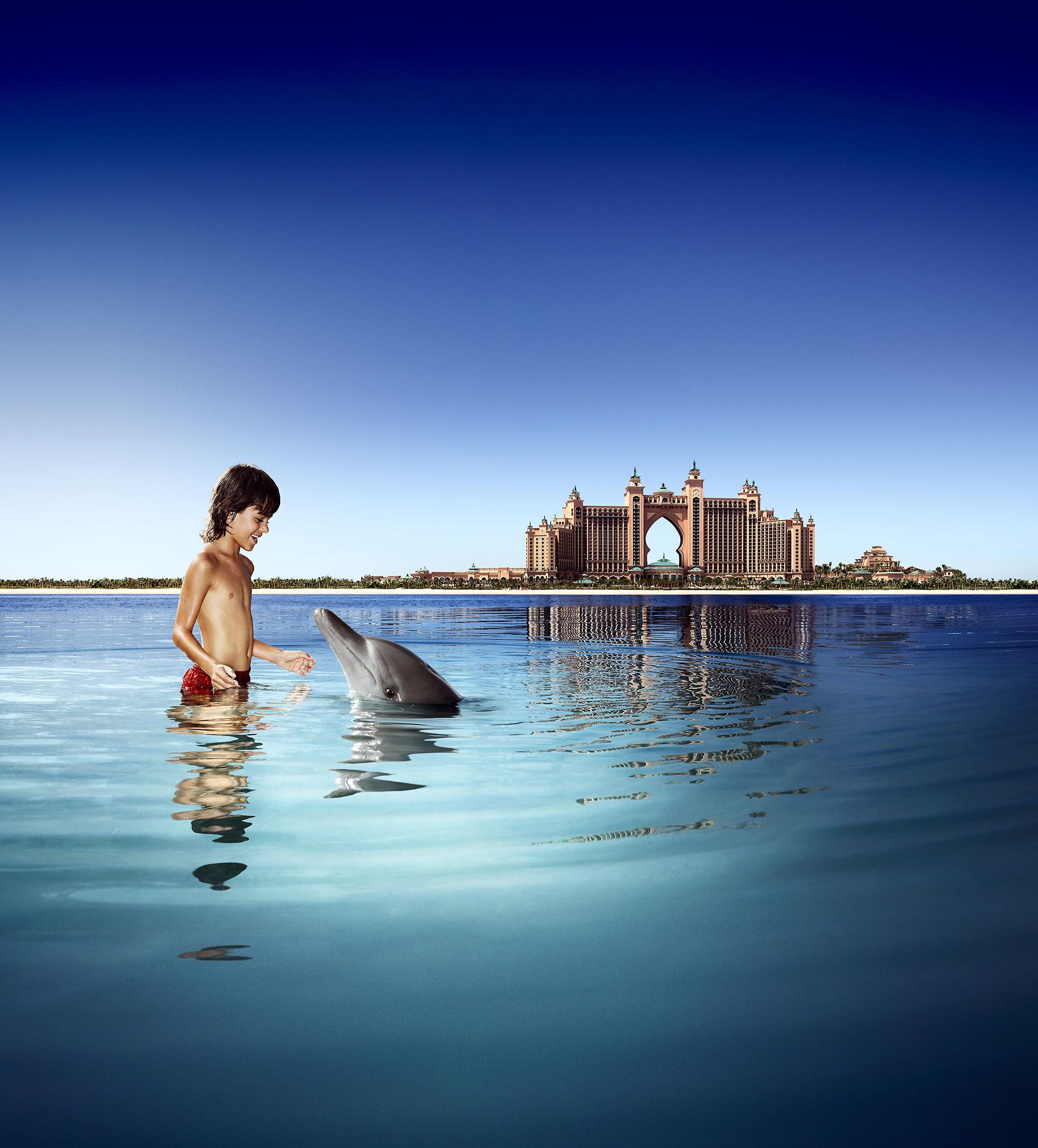 Karan Kapoor boy with dolphin in pool
