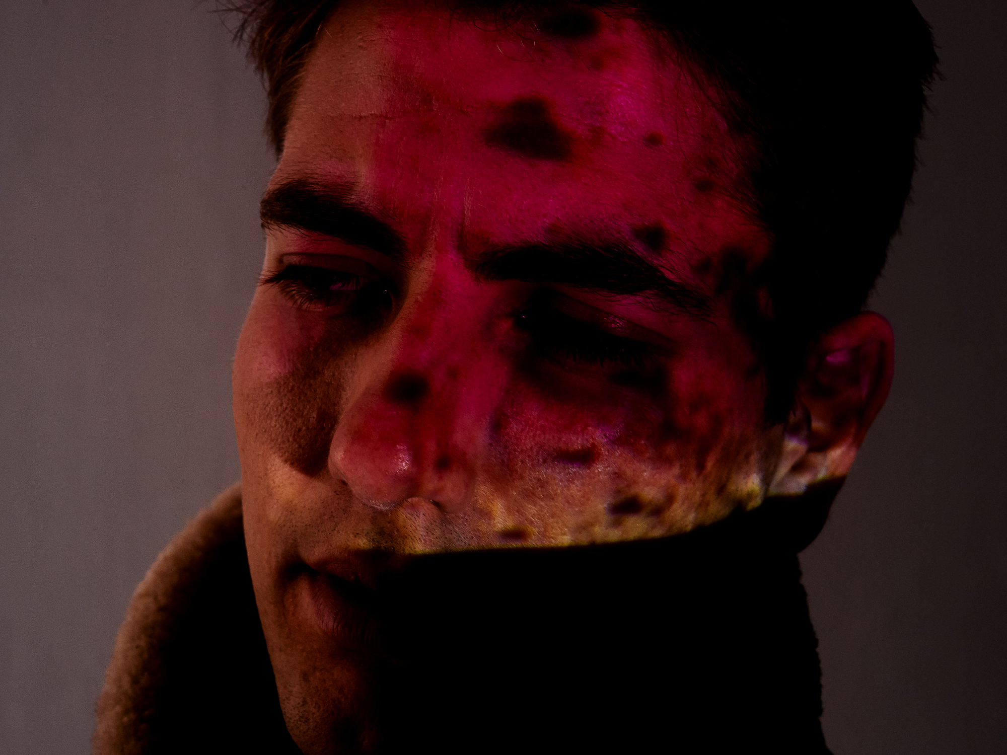 Noel McLaughlin - portrait shot man with flying jacket