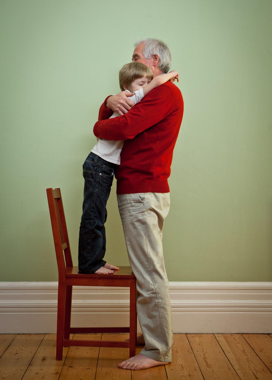 Tim Platt - grandad hugging grandson