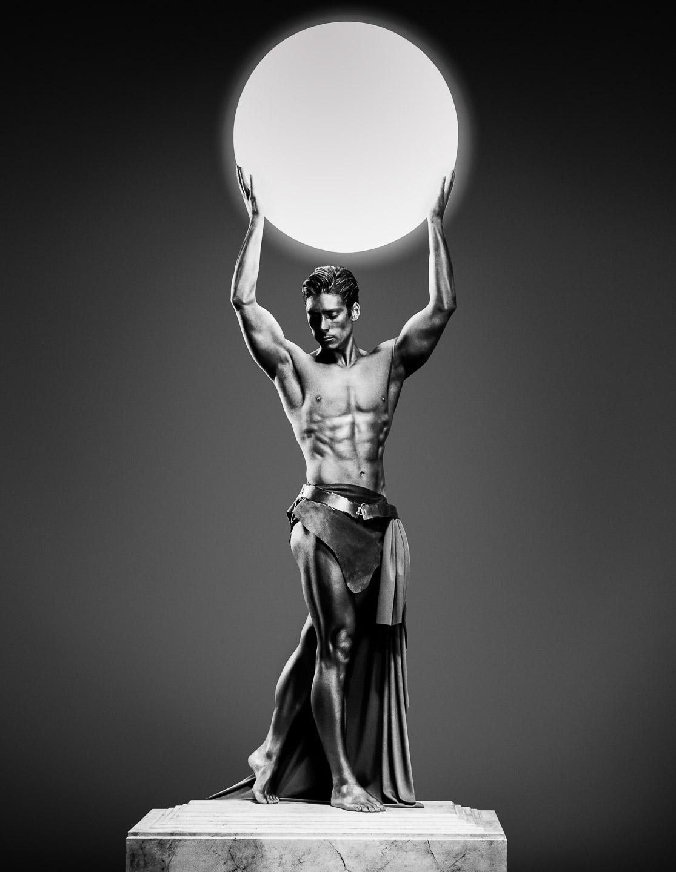 Tim Platt - iconic image of Man holding ball in plinth