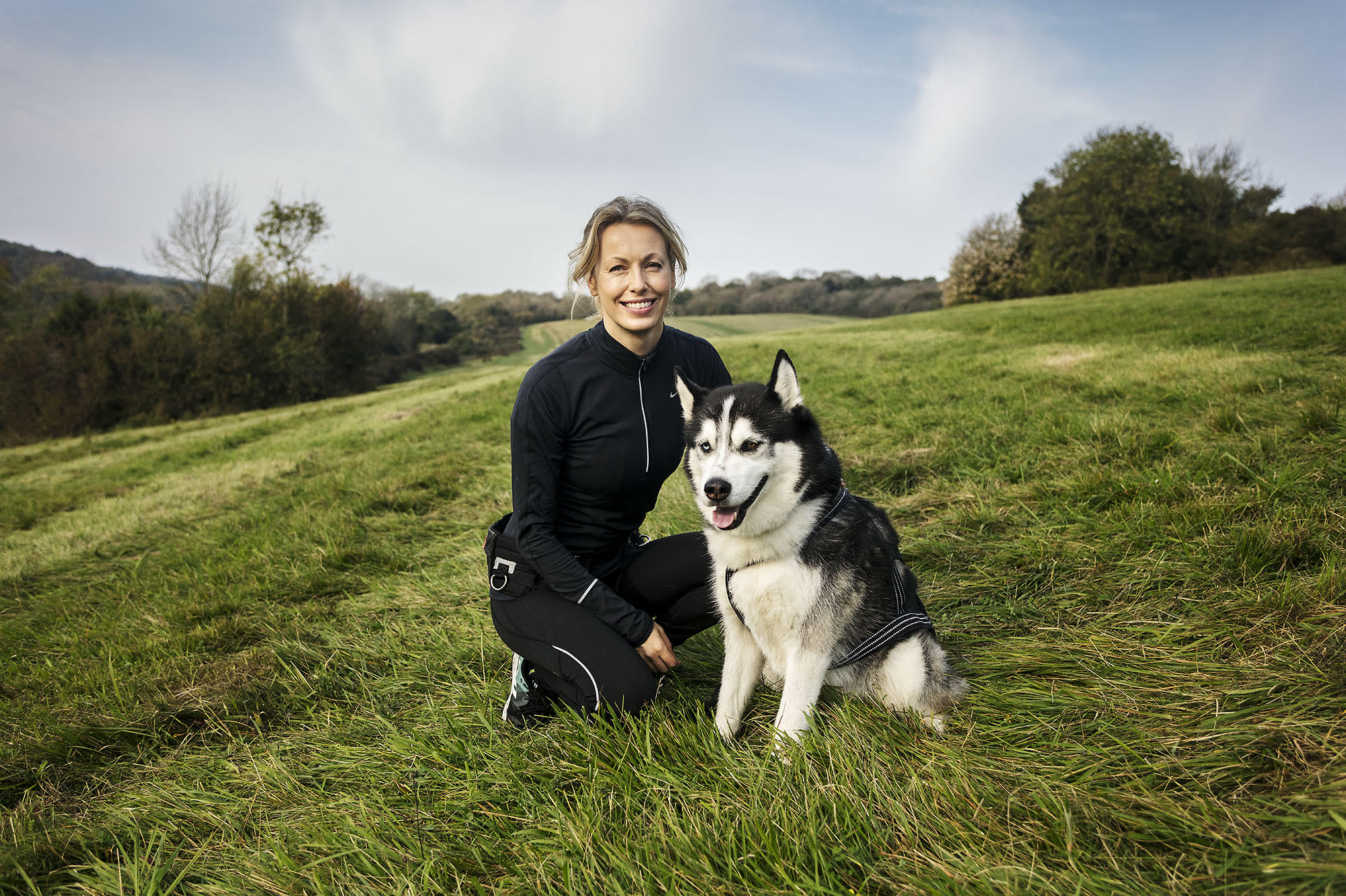 Karan Kapoor - woman and dog in field