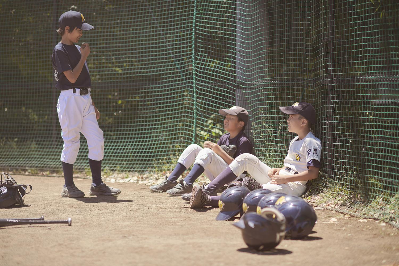 Dee Ramadan - boy resting from baseball game Tokyo