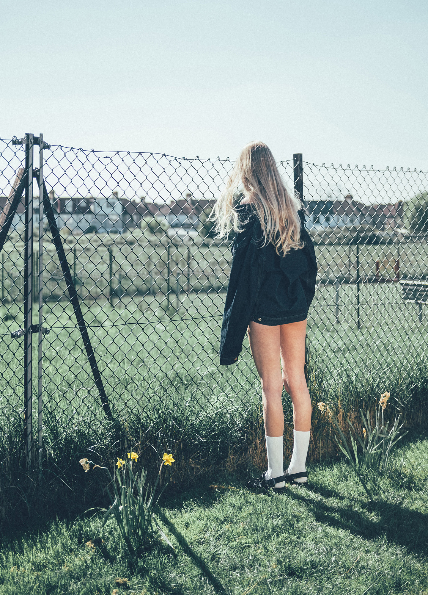 Ira Giorgetti girl looking over fence