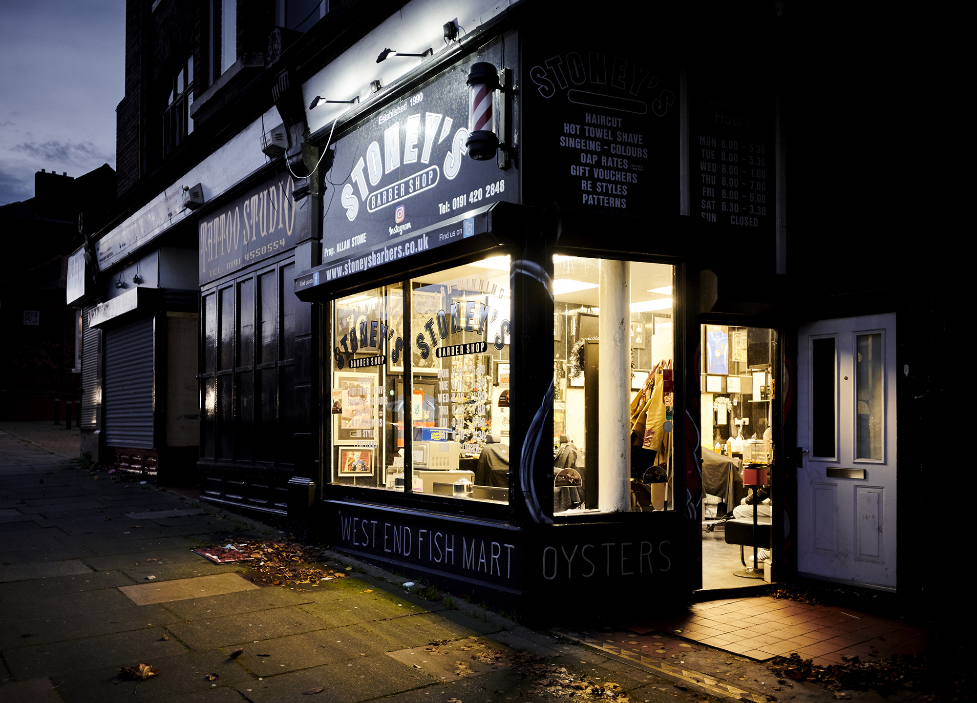 John Donoghue - outstdie barbers shop evening
