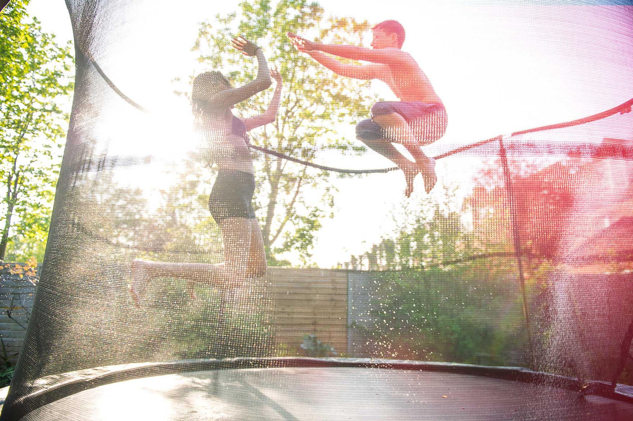 Dean Northcott - girl and boy on trampoline