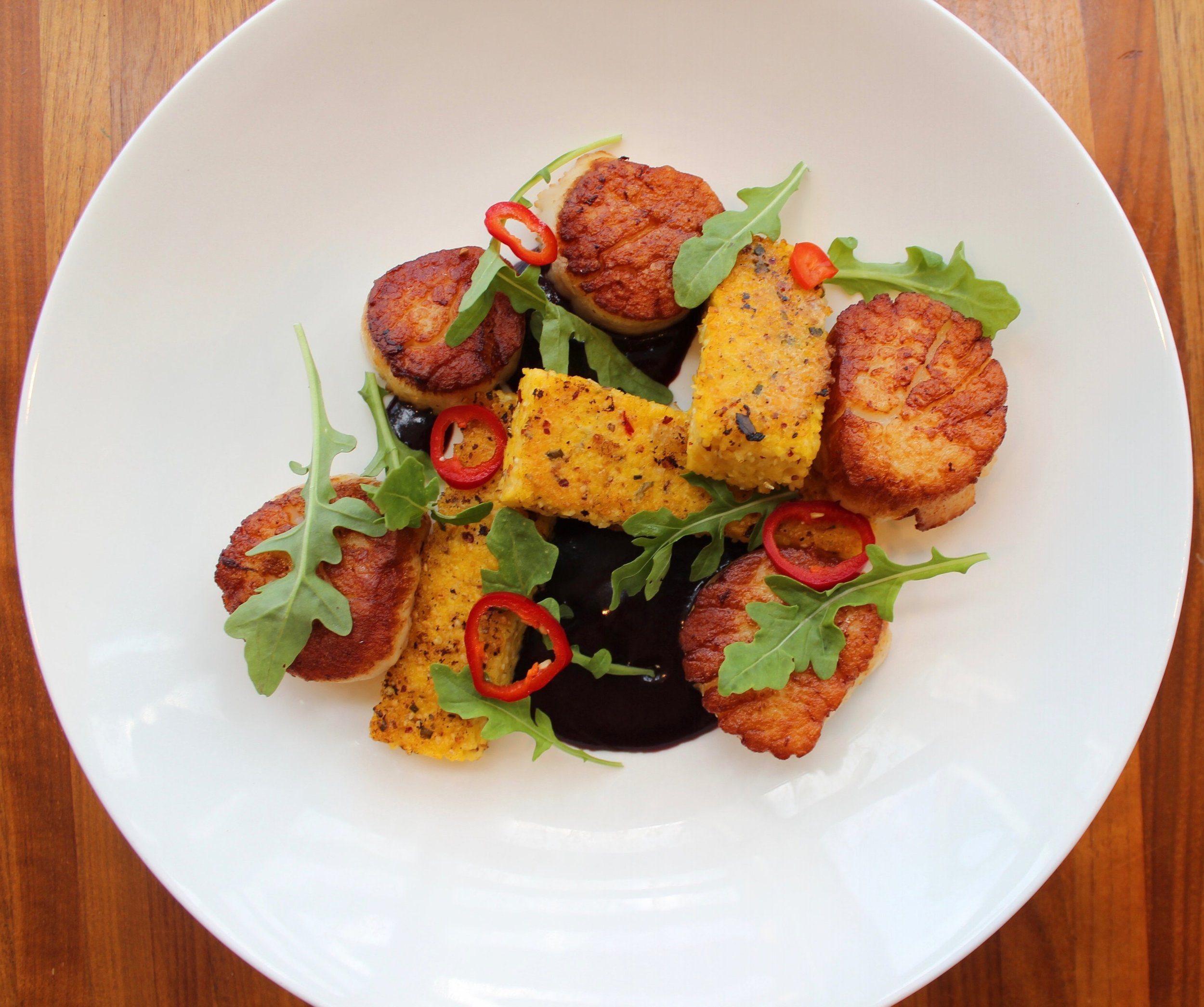 Scallops with coriander-fresno-spiced polenta cakes, blackberry ketchup, pickled fresno peppers, and arugula