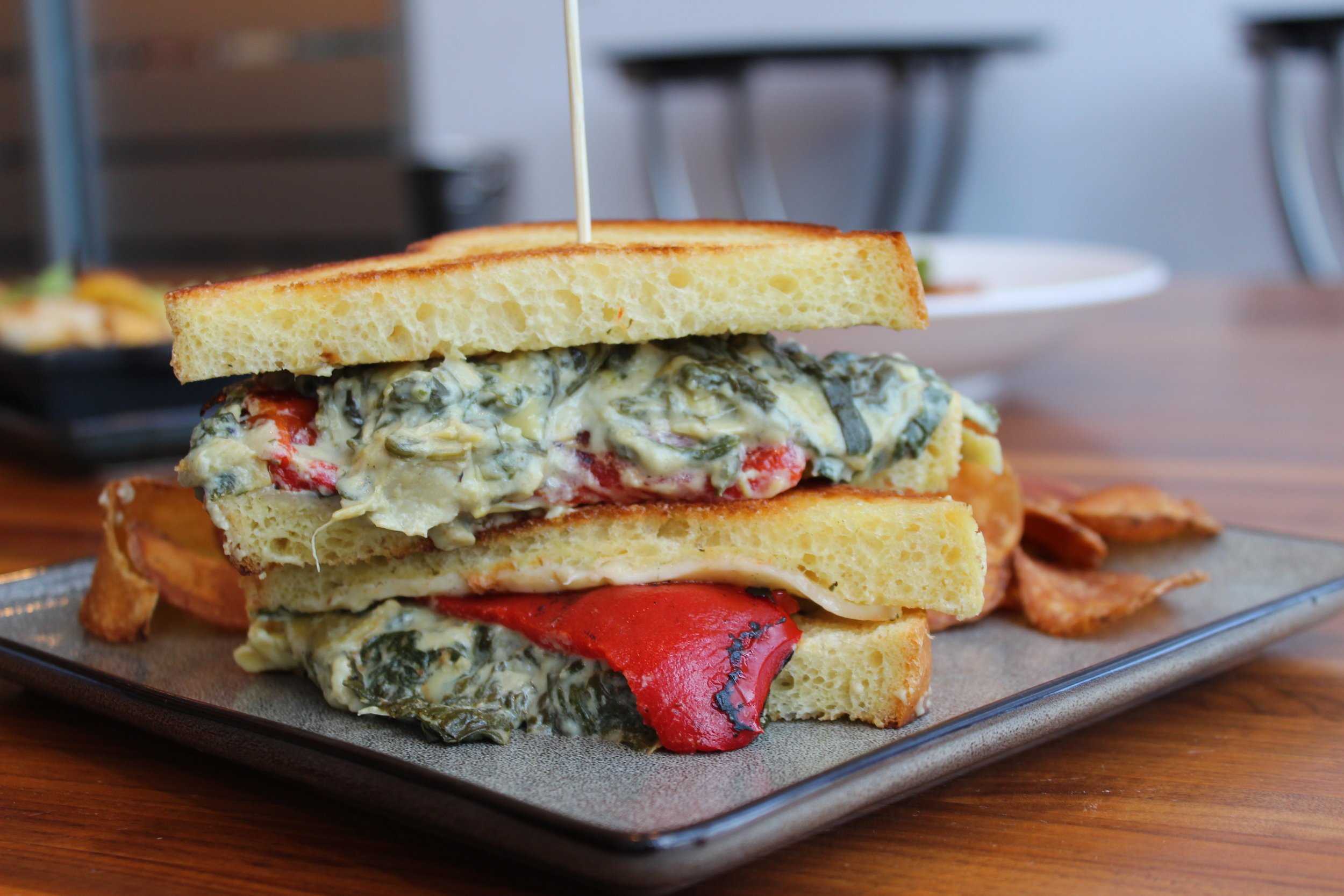 Spinach Artichoke Grilled Cheese, with spinach, artichoke, Boursin cheese, roasted red pepper, on sliced brioche