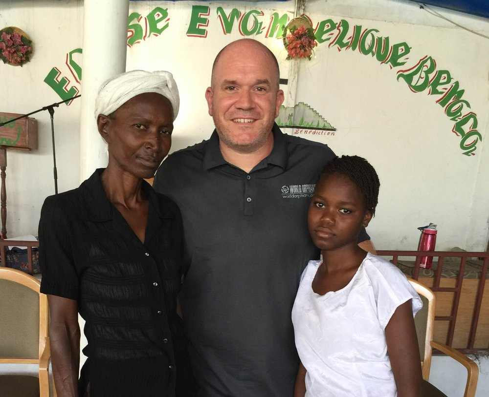 Frimose, Church Partnership Director Kevin Squires, and Saraphina