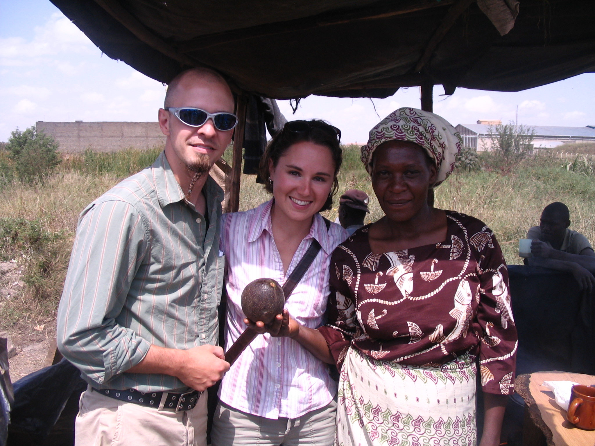 Kate and her husband with a woman in Kenya