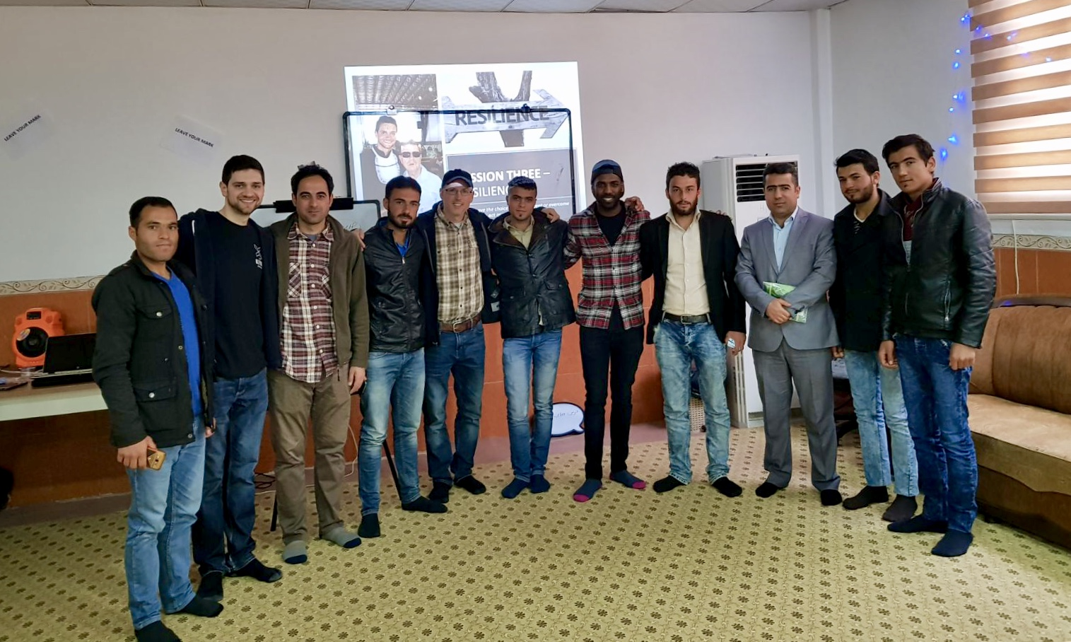 Billy with the ten Syrian men that completed the Strength program