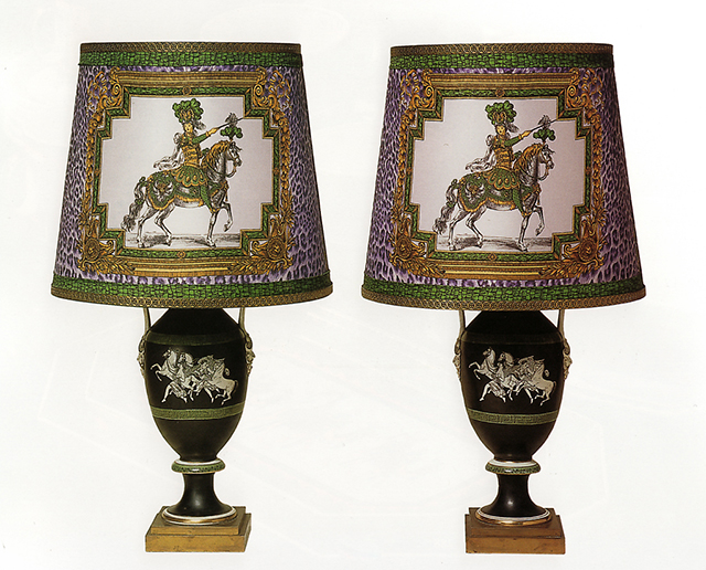 A Pair of Neoclassical Style Porcelain Vases mounted as Lamps, Late 19th Century; Gianni Versace designed silk lampshades in the 'Le Roi Soleil a Cheval' pattern combined with animal print backgroun