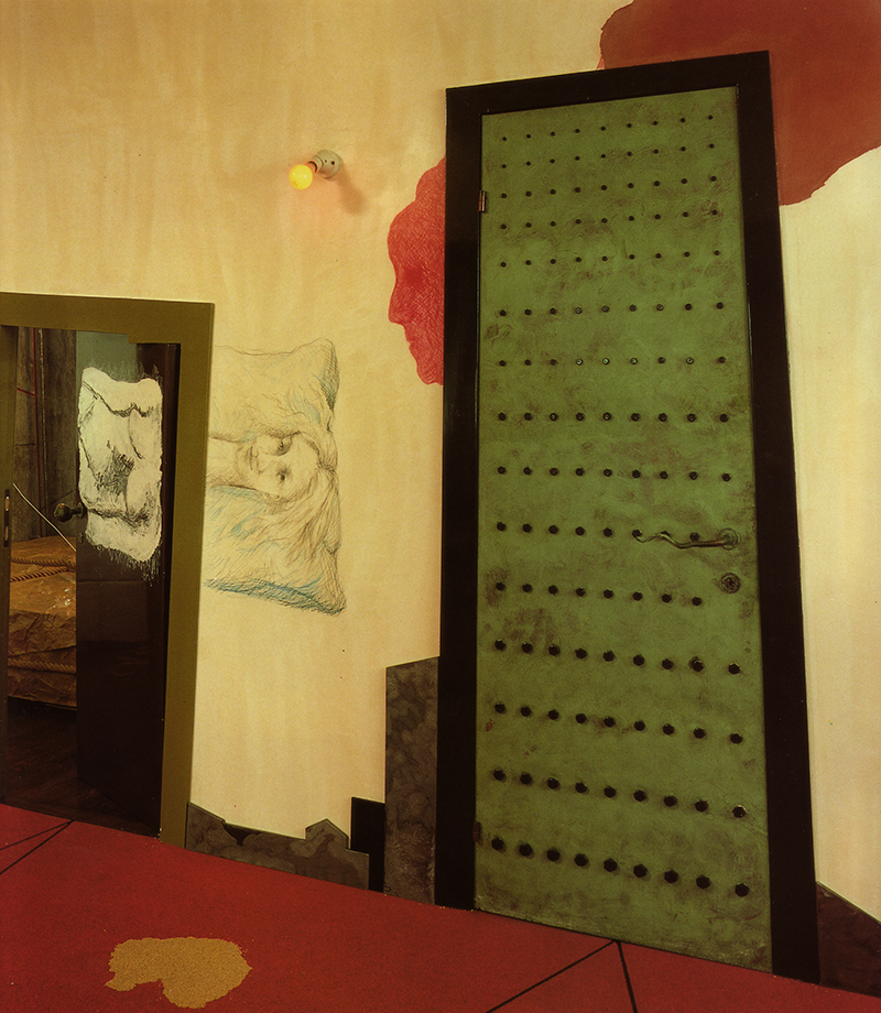 "ABOVE: ""The door to the right, designed to look like a vault, leads to a filing area. To the left is the low door to the guest bedroom. The drawings, by Pesce, were originally inspired by Picasso."" [2]"