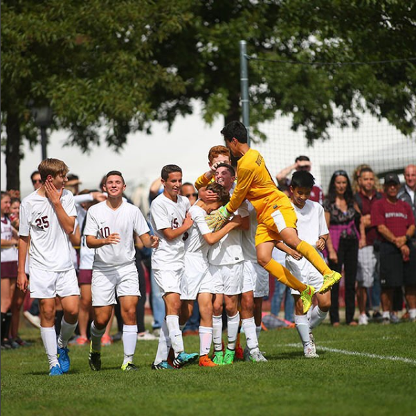 The Boys Varsity Soccer Team Exhilarated After Championship Game.