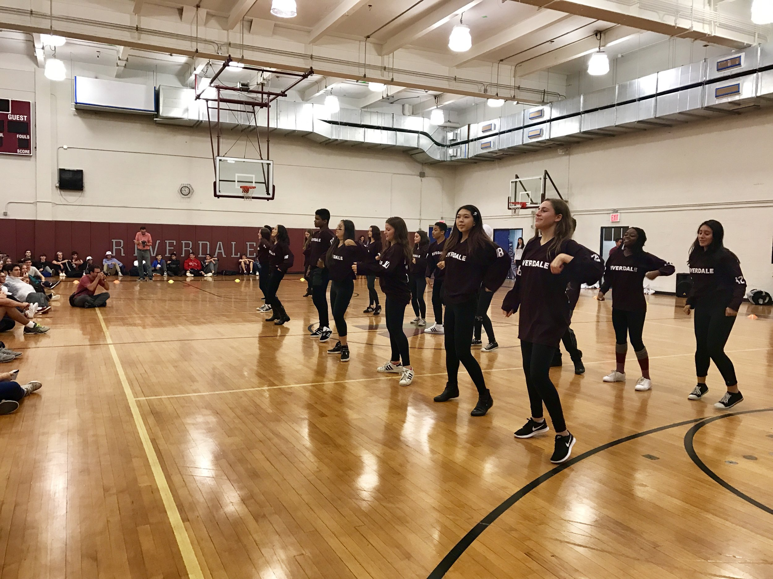 Photo courtesy of David Kenas Photography  The Riverdale Dance team performs at the Homecoming Prep Rally.