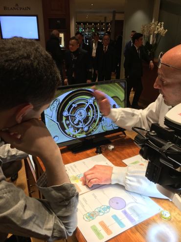 PHOTO COURTESY OF THE RIVERDALE REVIEW   BLANCPAIN WATCHMAKER EXPLAINING THE CARROUSEL MOVEMENT