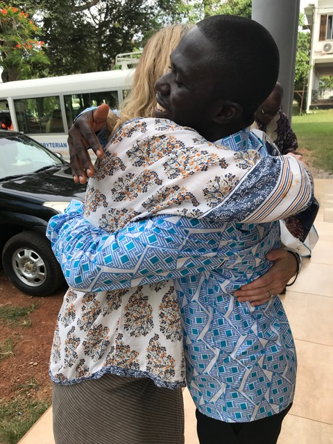 The Rev. Father Theo Odametey and the Rev. Canon Dr. Sharon Hiers greet one another.