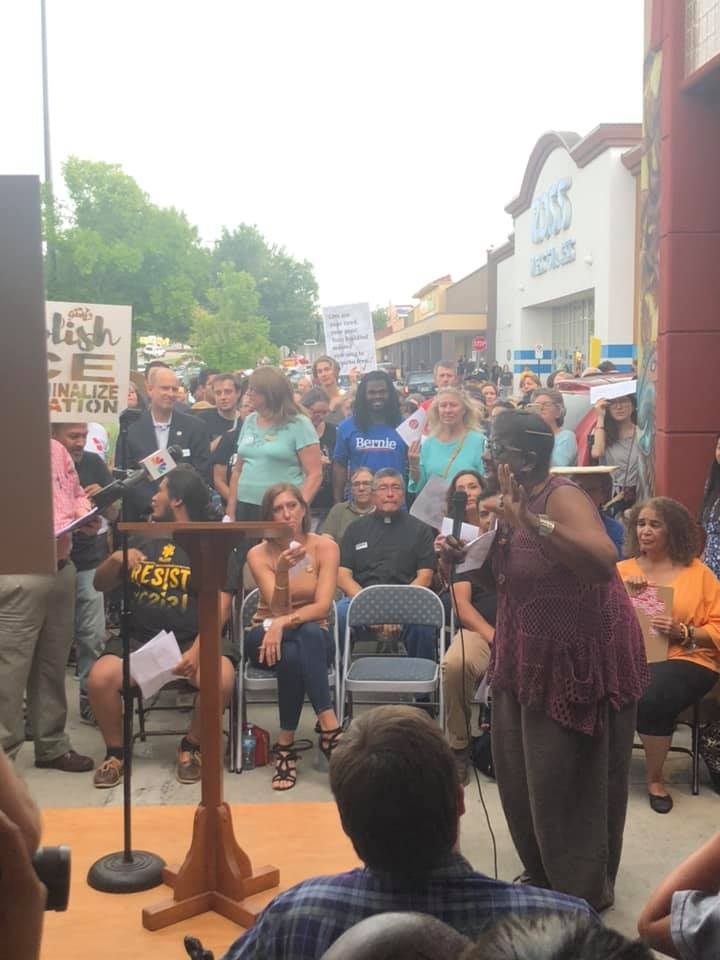 Catherine Meeks addresses the hundreds gathered at Plaza Fiesta in Chamblee for the Lights for Liberty event.  Photo credit Feroza Syed