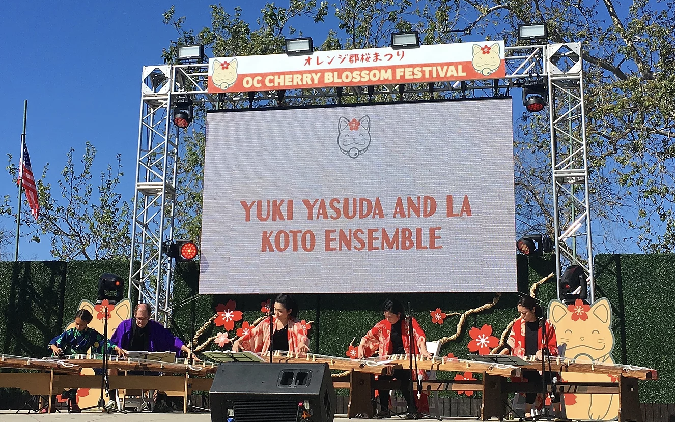 LA Koto Ensemble - Japanese koto player Yuki Yasuda is based in Los Angeles, California. She was born in Japan and began playing the koto at age twelve. She later majored in koto music at the Takasaki Junior Arts College and also received rigorous koto instruction under the tutelage of Tadao Sawai and Kazue Sawai, the masters of great modern koto music.