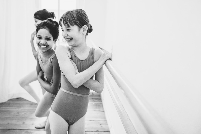 laughing girls in ballet leotards