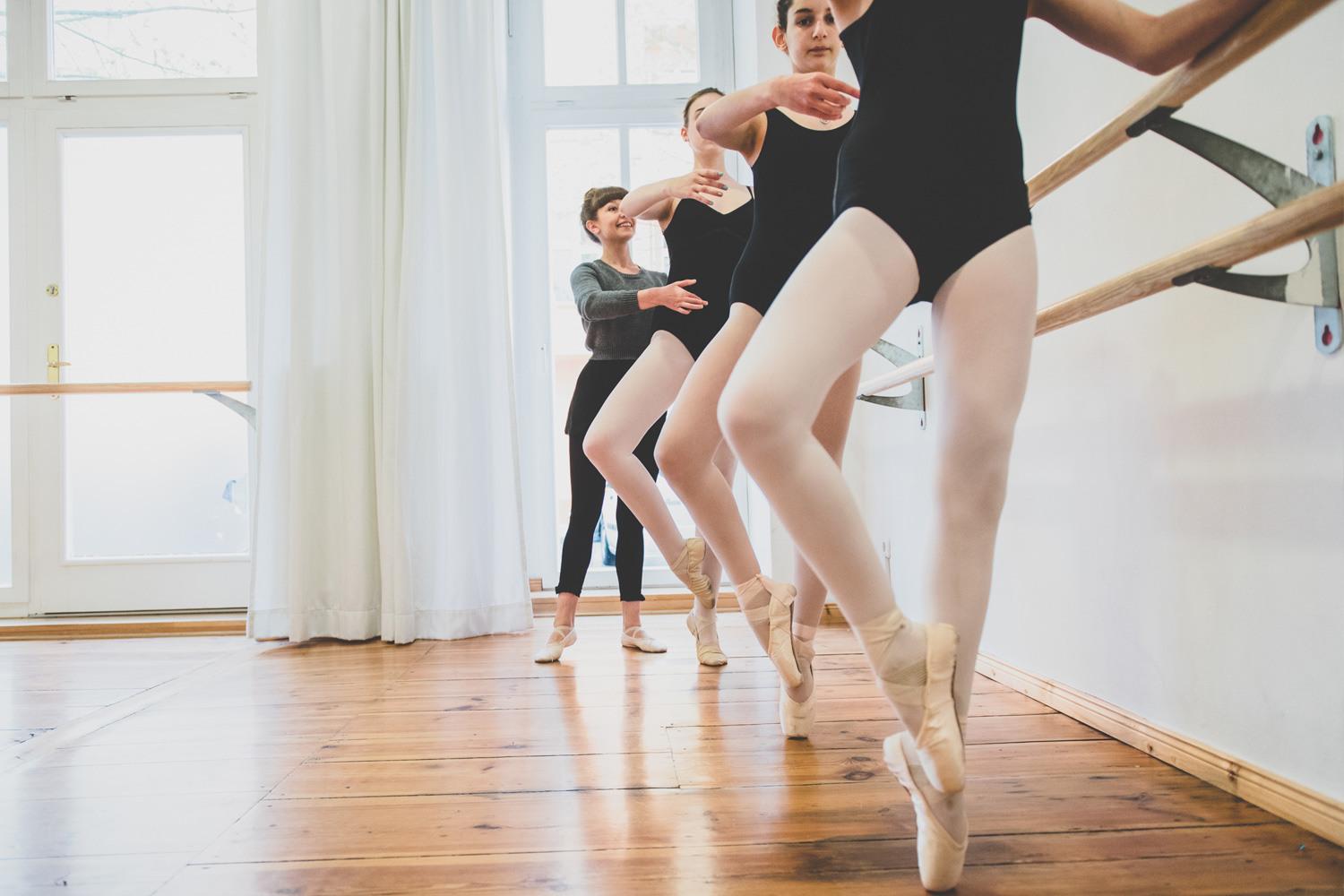 Copy of teenage girls at ballet barre in pointe work class