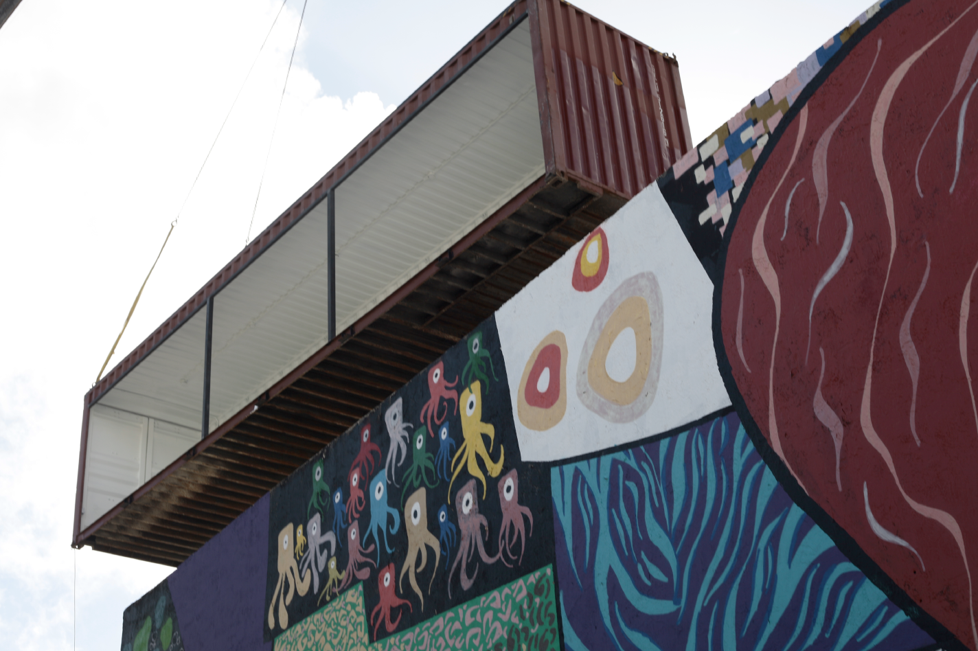 The Market container is welcomed home by The Yard mural.