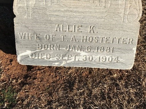 Gravestone damaged by improper trimming techniques. Weed whips may be used - with extreme care - with the lightest possible nylon string.