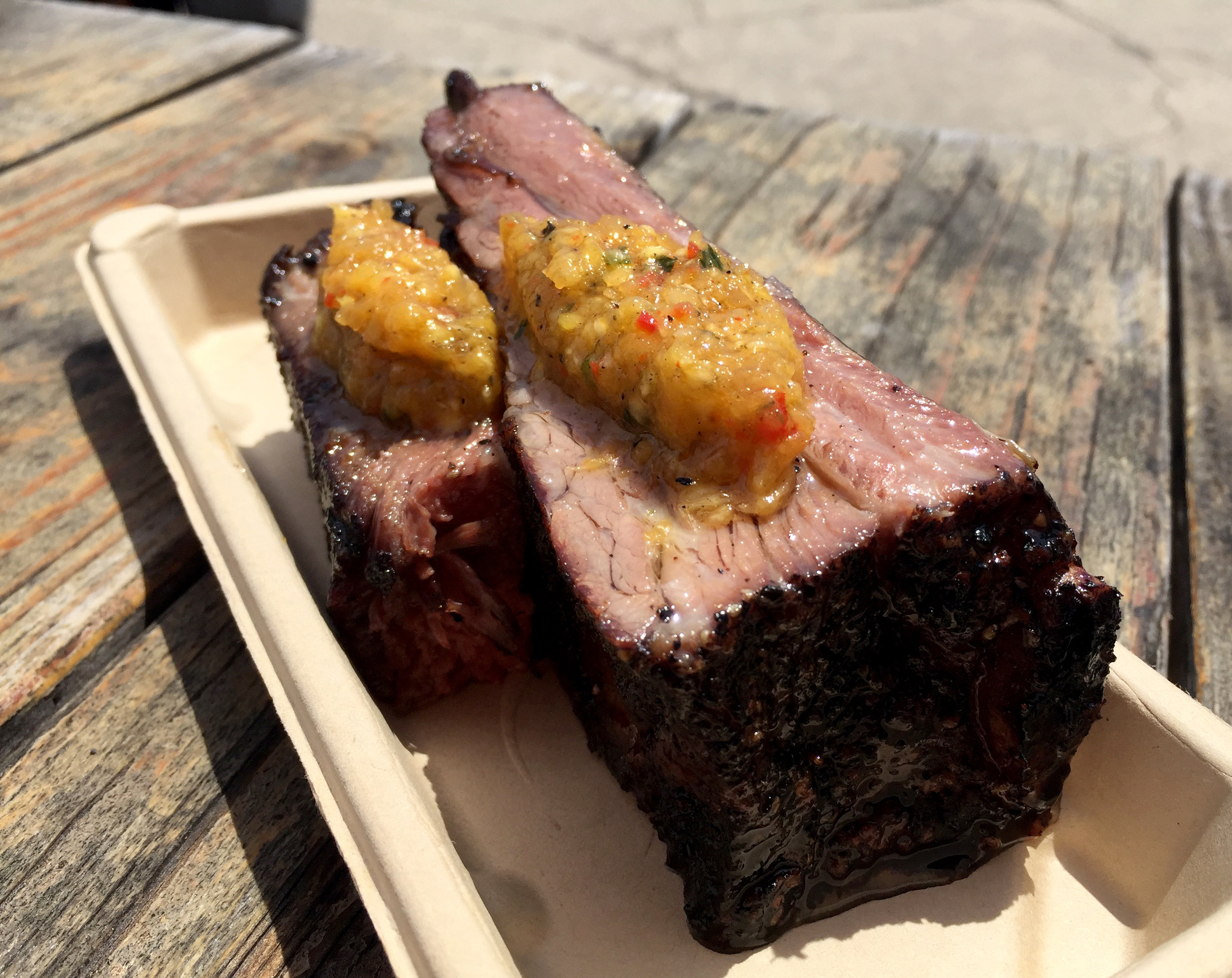 Photo Credit:  Anna Bryant   This is my #mcm every week....that stands for meat crush Monday, right? this beef rib is so tender it falls off the bone and goes great with the pineapple salsa on top.