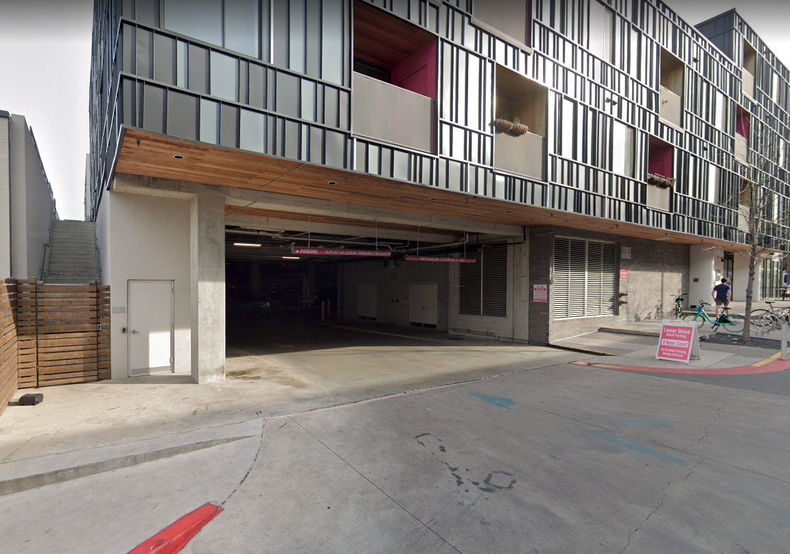Building 2  / retail parking garage entrance with PINK height markers.